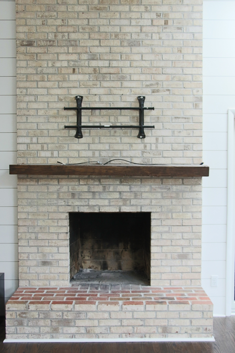 How To Whitewash Your Brick Fireplace With Milk Paint The Greenspring Home