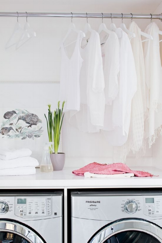 All white laundry room | Folding counter laundry room | Hanging rod laundry room