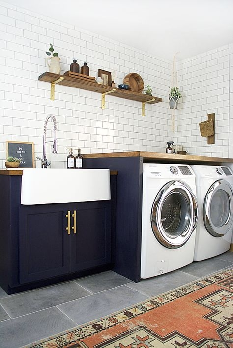 Modern Farmhouse Laundry Room Ideas | Front load washer and dryer | Wood Laundry Room Countertop | Folding Countertop | White subway tile