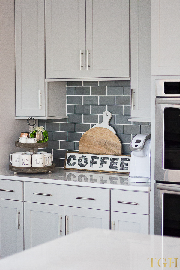 Rae Dunn Mugs | Gray and White Kitchen | White Quartz Countertop Kitchen | Gray Kitchen Cabinets | Glass Subway Tile Backsplash | Kitchen Decorating Ideas | Modern Cabinet Pulls | Stainless Steel Cabinet Pulls