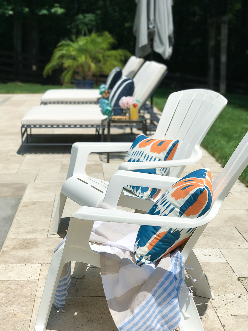 Come get pool patio furniture ideas like these chaise lounges and adirondack chairs by the pool!