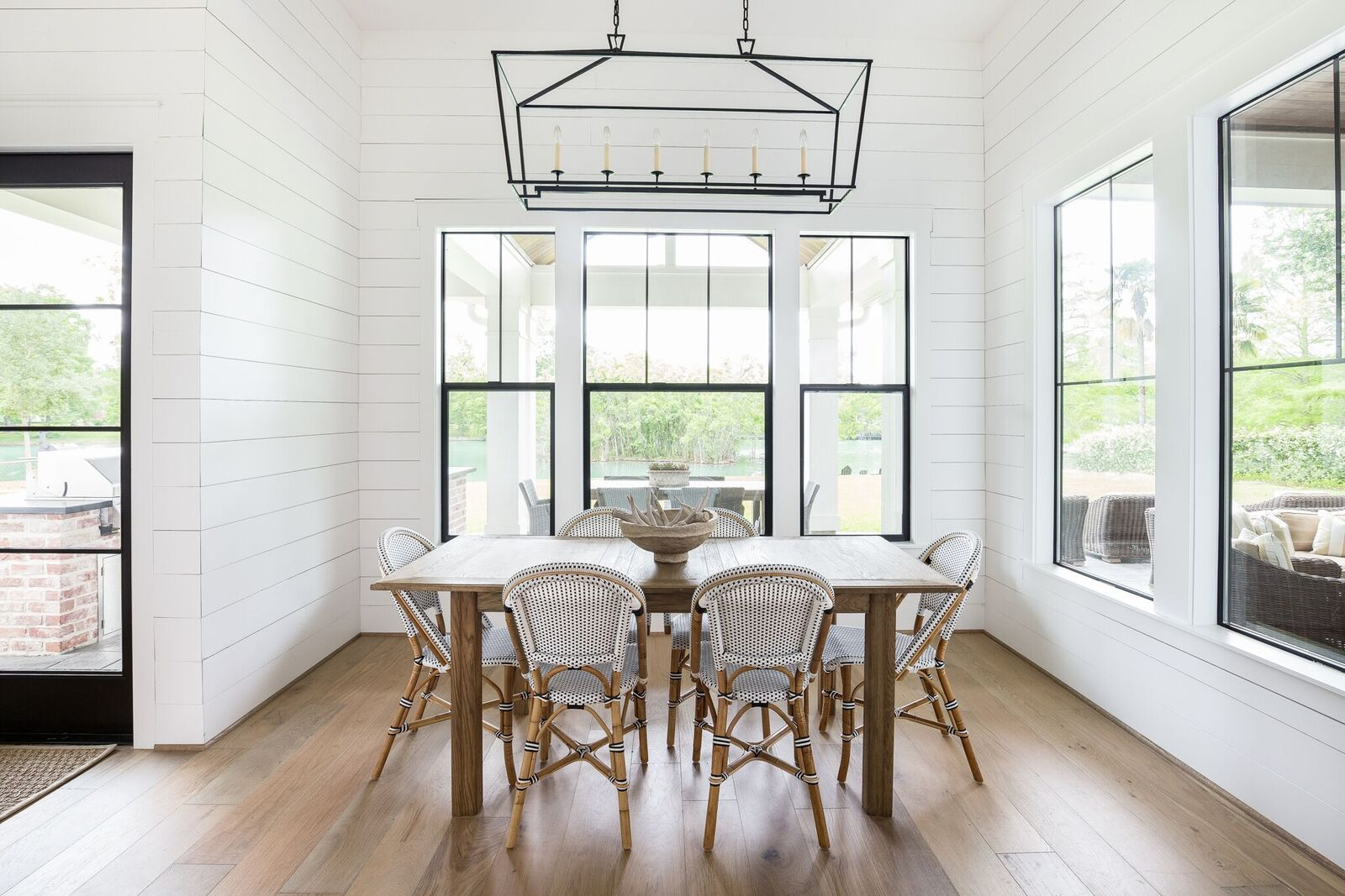 Come see this modern farmhouse featuring a breakfast nook with shiplap walls and black windows with white trim.
