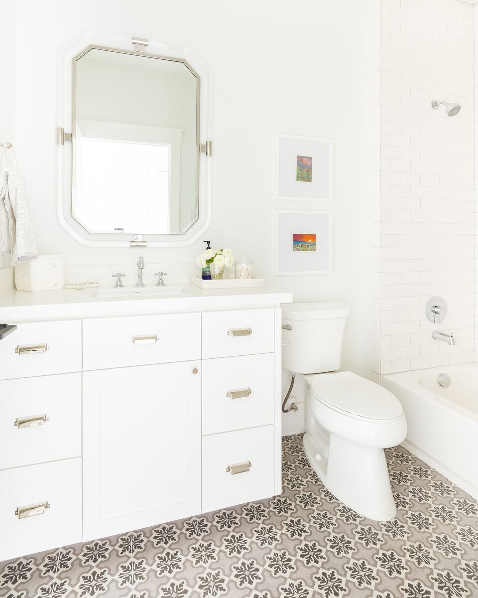 Come see this luxury home featuring a guest bathroom with this unique pattern tile floor.