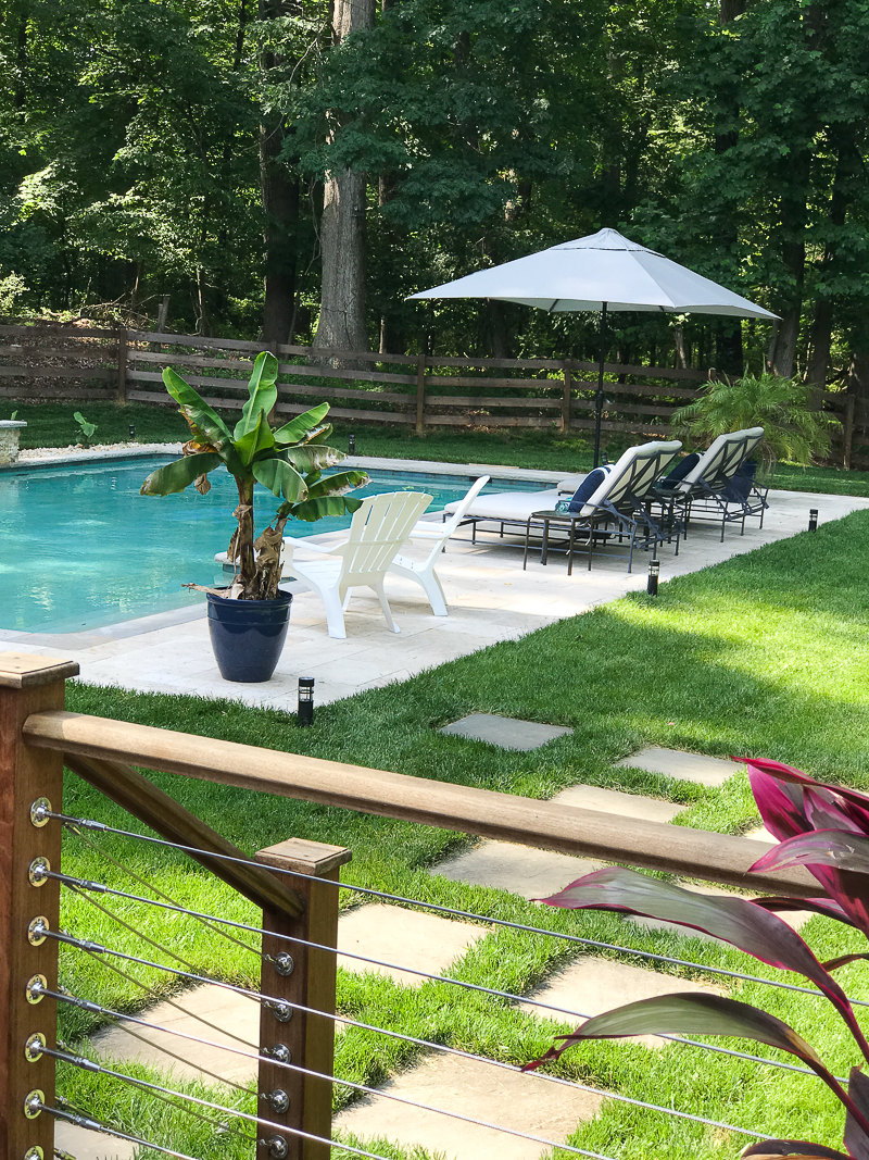 Come see this backyard layout with a pool on this bloggers Summer Outdoor Living Tour!