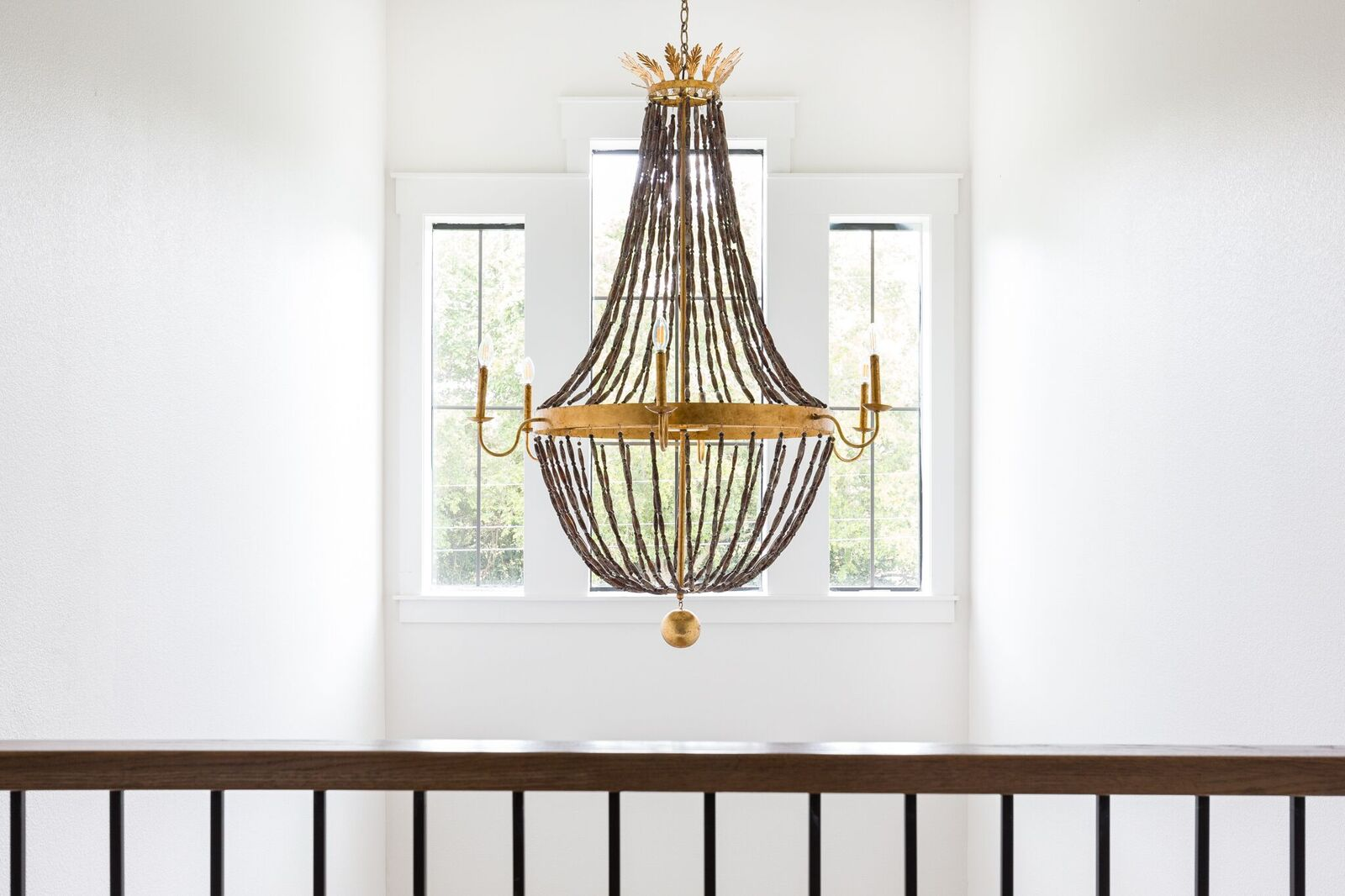 Come see this modern farmhouse featuring a one of a kind beaded chandelier in this two story foyer.