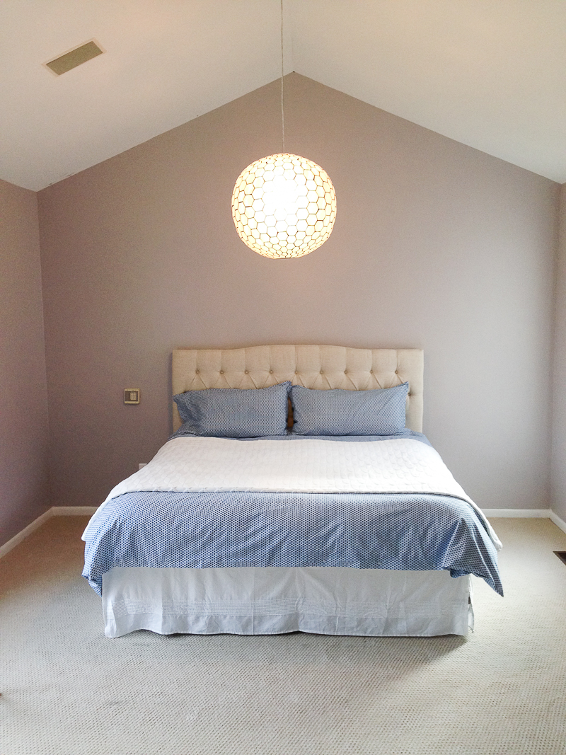 Click to see this drastic master bedroom makeover featuring grasscloth wallpaper, open nightstands, and a canopy bed!