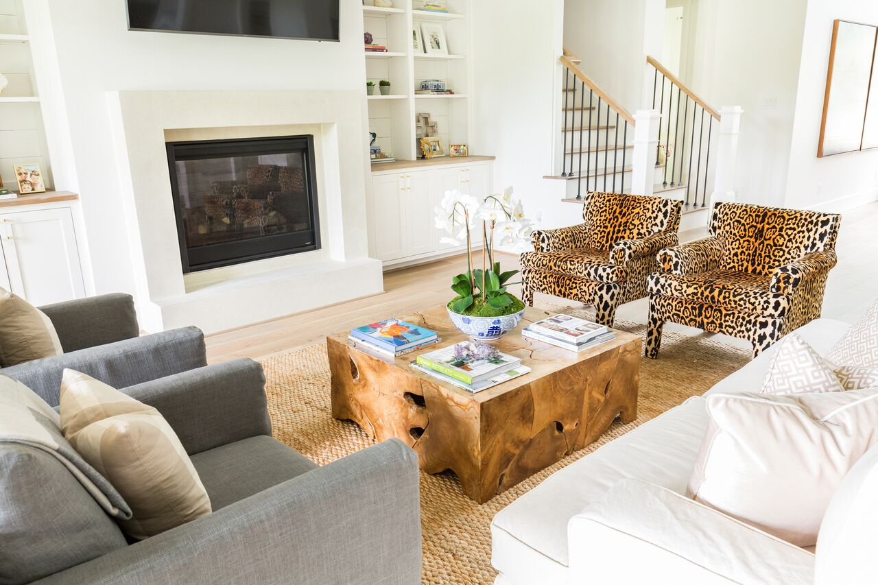 Come see this modern farmhouse featuring an open concept living room layout with built in shelves.
