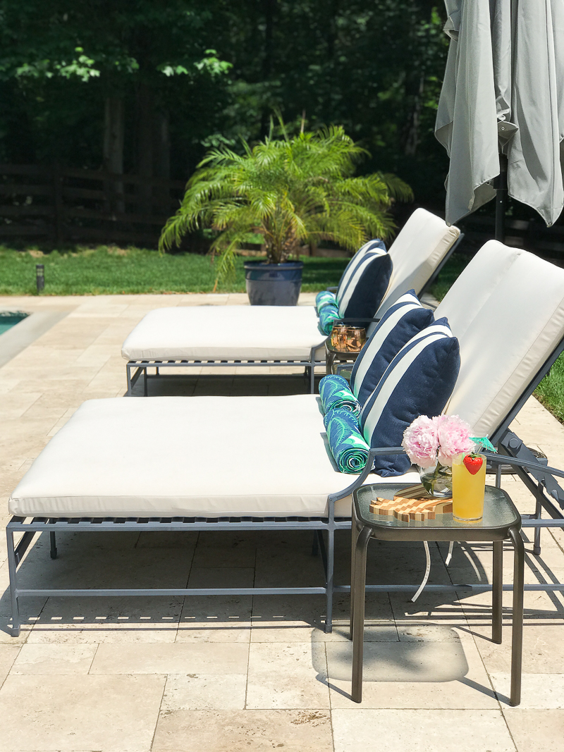 Come get pool patio furniture ideas like these double chaise lounges and adirondack chairs by the pool!