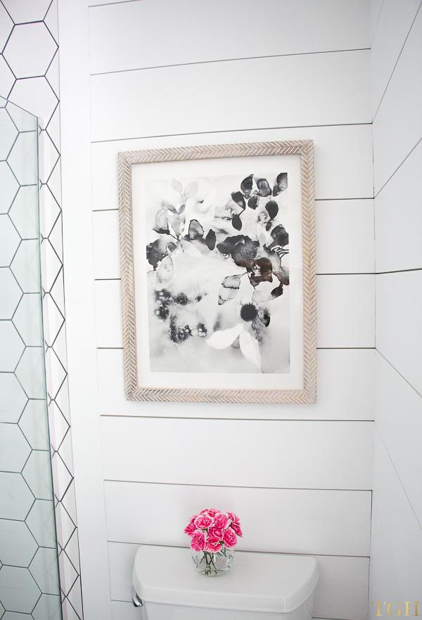 Black and white wall art with a herringbone light wood frame