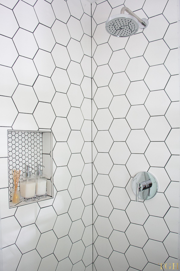 Pool bathroom makeover with white hexagon shower tiles