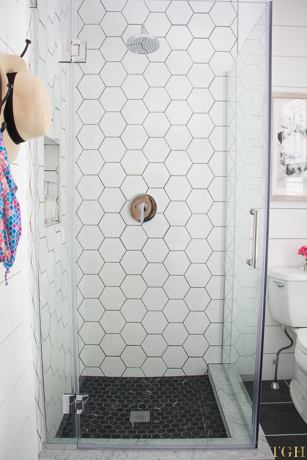 Pool bathroom makeover with white hexagon tile and shiplap