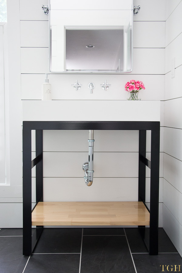 Come see this custom steel vanity in this small bathroom makeover