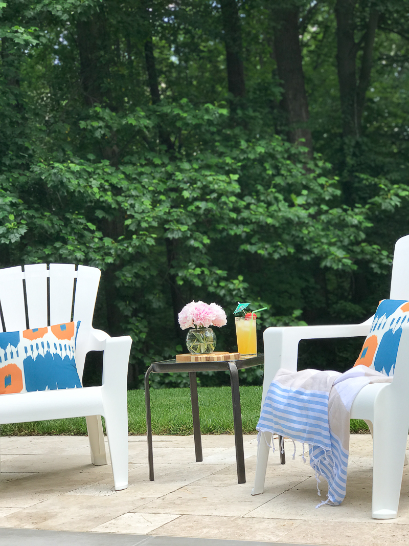 Come see this relaxing outdoor space with adirondack chairs by the pool on this bloggers Summer Outdoor Living Tour!