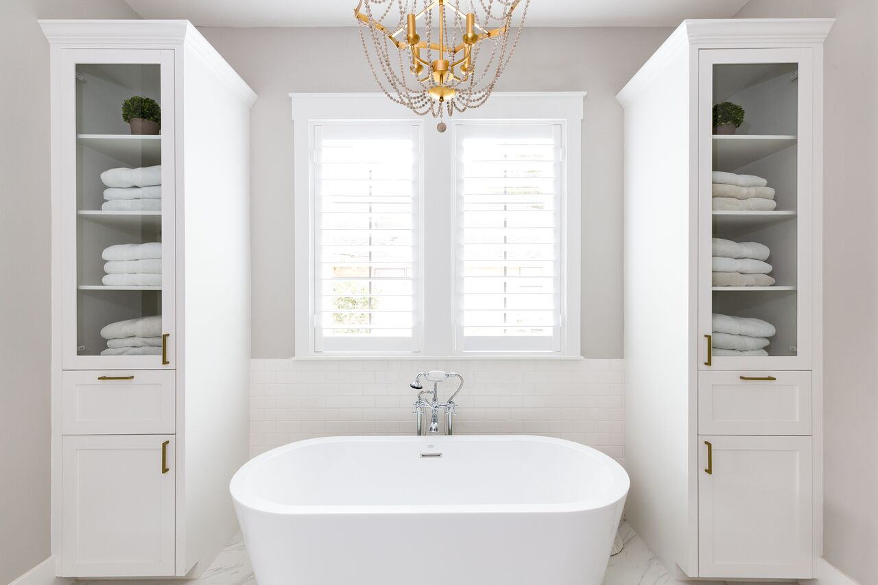 Come see this luxury home featuring a master bathroom with built in storage, marble tile floors, and a freestanding bathtub.