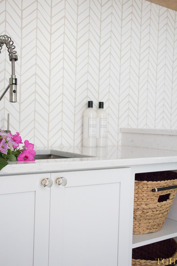 Modern laundry room makeover with The Laundress products as pretty laundry room decor.