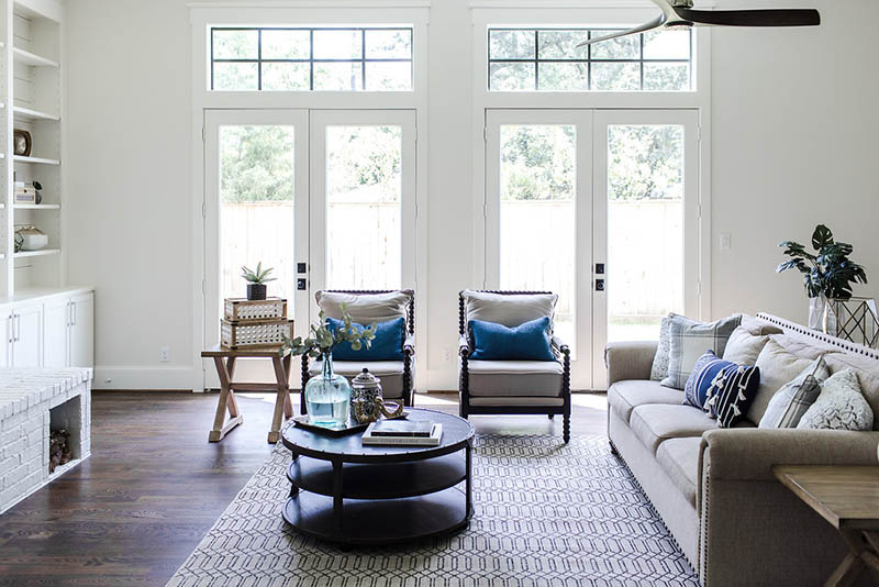 White living room walls. Tall patio doors. White living room furniture ideas.