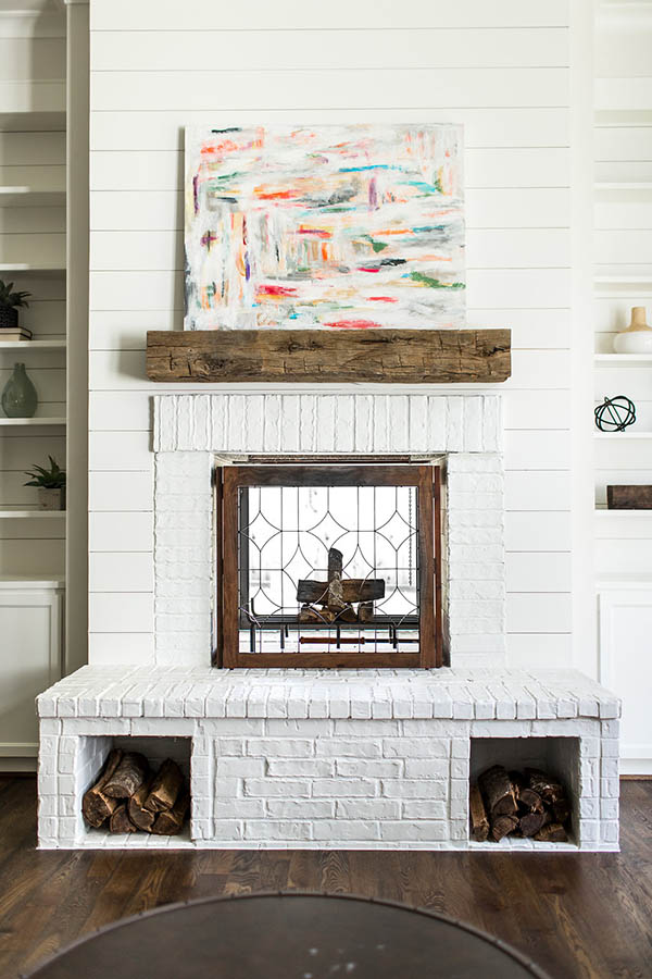 Unique fireplace ideas living rooms. Built in firewood holder. Painted white brick fireplace hearth.