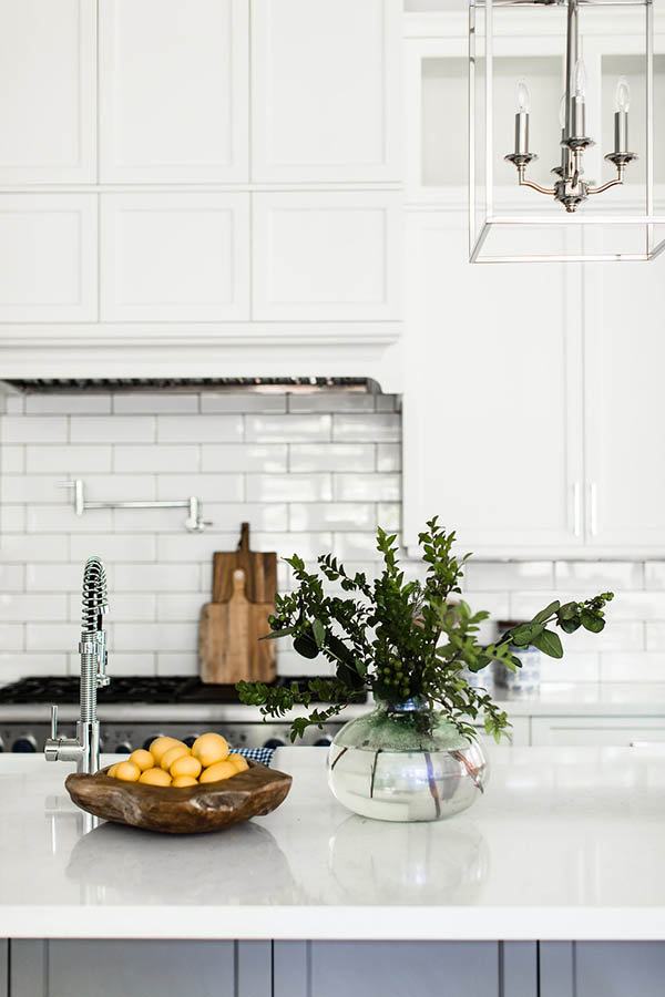 Long white subway tile backsplash. White kitchen decorating ideas. Modern farmhouse kitchen cabinets.