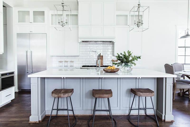 White kitchen gray island. Lantern pendants over island. Modern farmhouse kitchen ideas layout.