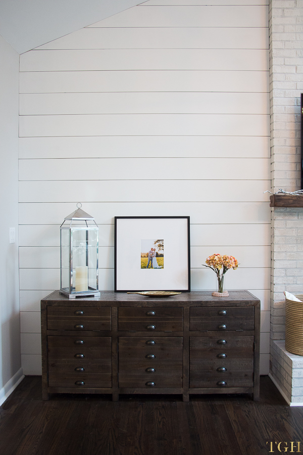 Media console decor ideas. Shiplap feature wall. Media console rustic modern. Vaulted ceiling living room.