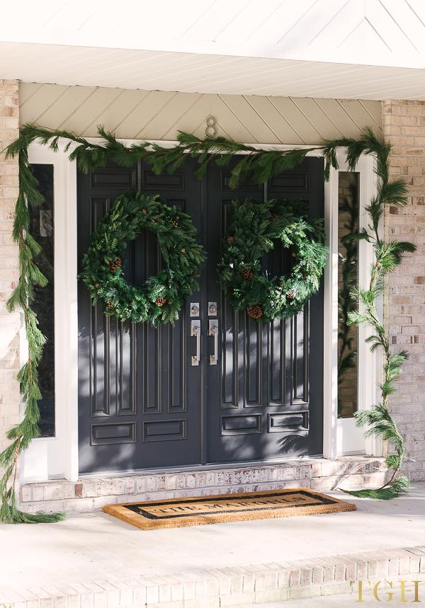 Fresh pine garland front doors. Two wreaths on double doors.