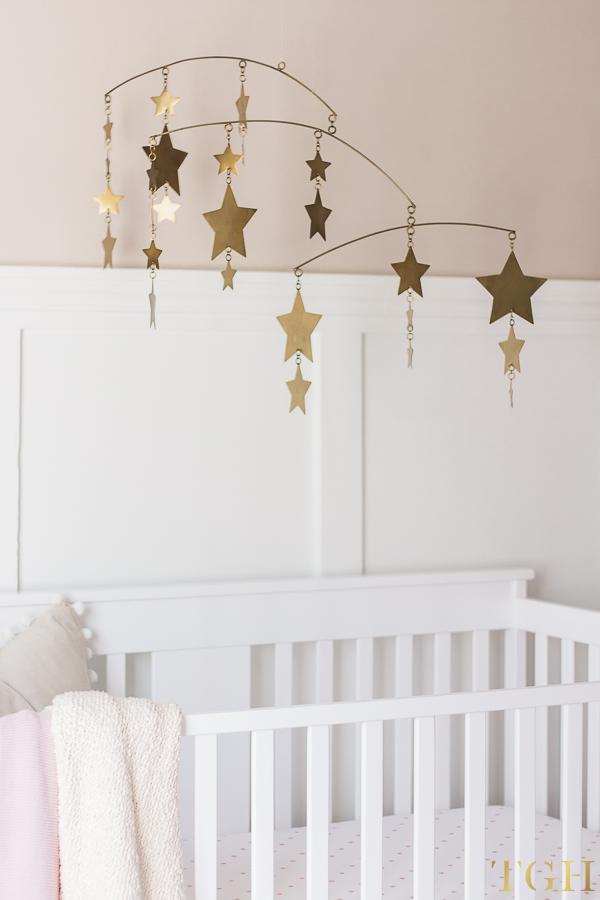 Gold Nursery Mobile Over White Crib