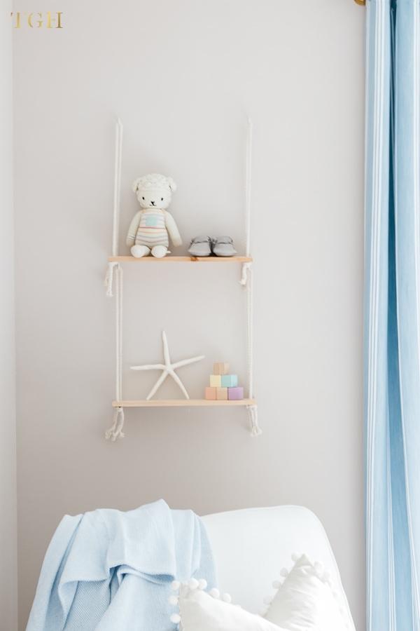 Baby boy nursery shelf styling