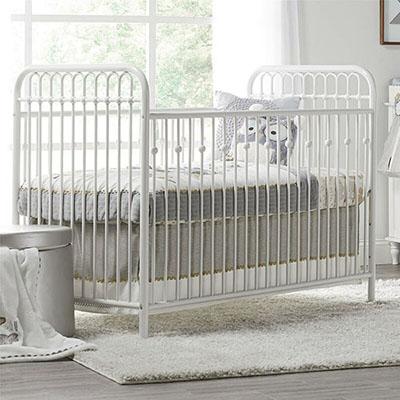 White metal baby crib
