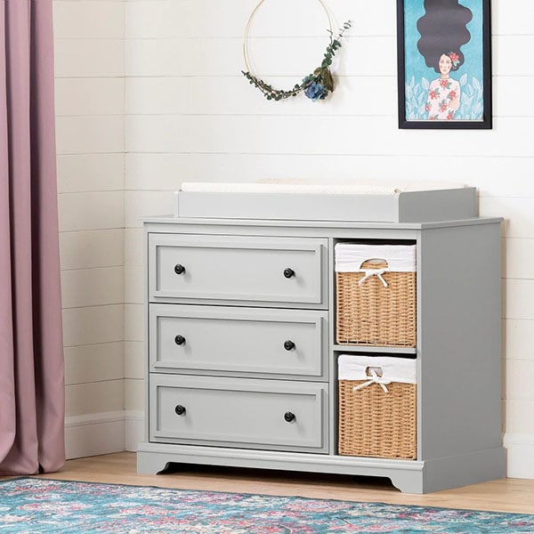 Gray nursery changing table with baskets