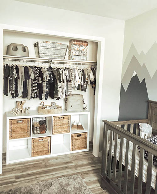 nursery closet with book shelf and baskets